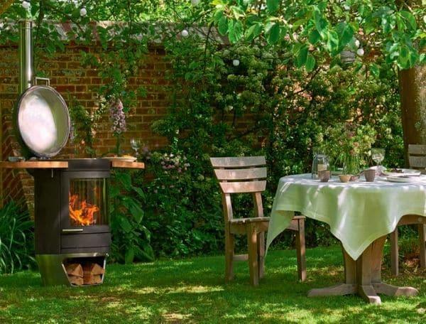 Extérieur convivial avec ce chauffage d'extérieur et barbecue - GardenSKoncept